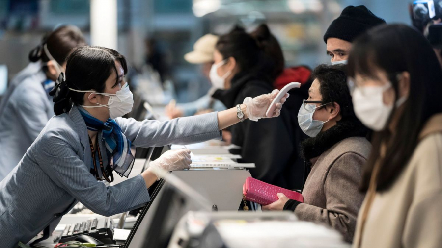 https___cdn.cnn.com_cnnnext_dam_assets_200219113446-coronavirus-temperature-check-0131-japan